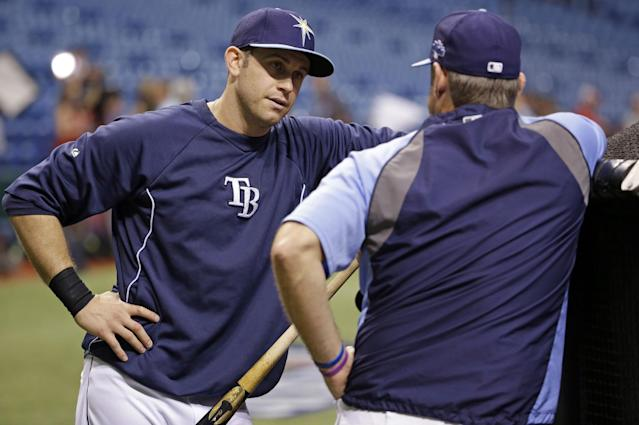 Tampa Bay Rays third baseman Evan Longoria, left, speaks with hitting coach Derek Shelton during practice before Game 3 of an American League division baseball series against the Boston Red Sox, Monday, Oct. 7, 2013, in St Petersburg, Fla. (AP Photo/Chris O'Meara)