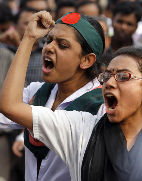FILE - In this Tuesday, Feb. 12, 2013 file photo, Bangladeshi students shout slogans demanding the execution of Jamaat-e-Islami leader Abdul Quader Mollah and others convicted of war crimes involving the nation's independence war in 1971, in Dhaka, Bangladesh. Mollah, an assistant secretary of Jamaat, was found guilty of killing a student and a family of 11 and of aiding Pakistani troops in killing 369 others. Members of his party took to the streets in anger at his conviction, exploding homemade bombs and clashing with police. But they were soon overshadowed by thousands of protesters who flooded a major intersection in the capital, Dhaka, upset at what they said was a lenient verdict and inflamed by the image of Mollah smiling at journalists and holding up two fingers in a ''V'' sign as he left the court. (AP Photo/Pavel Rahman)