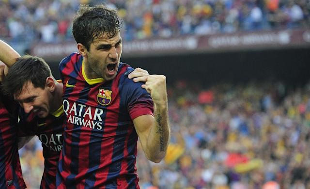 FC Barcelona's Cesc Fabregas, right, and Lionel Messi from Argentina, left, celebrate Neymar's goal against Real Madrid during a Spanish La Liga soccer match at the Camp Nou stadium in Barcelona, Spain, Saturday, Oct. 26, 2013. (AP Photo/Manu Fernandez)
