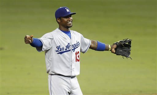 Los Angeles Dodgers player Hanley Ramirez celebrates after the Dodgers defeated the Miami Marlins during a baseball game in Miami, Friday, Aug. 10, 2012. The Dodgers won 5-2. (AP Photo/J Pat Carter)