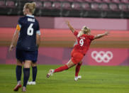 Canada's Adriana Leon, right, celebrates scoring her side's opening goal against Great Britain during a women's soccer match at the 2020 Summer Olympics, Tuesday, July 27, 2021, in Kashima, Japan. (AP Photo/Fernando Vergara)