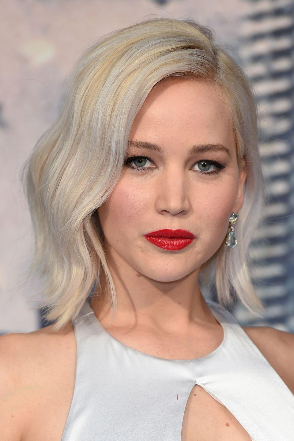 <p>Lawrence gave her white blonde hair a Nordic silver twist.</p>