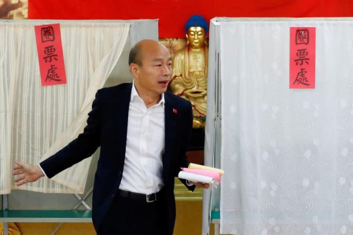 Taiwan's opposition Kuomintang Party (KMT) presidential candidate Han Kuo-yu arrives to cast his vote at a polling station during general elections in Kaohsiung