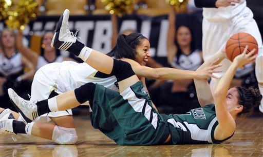 Arielle Roberson, left, of Colorado, tries to get the ball from Sammie Jensen of Utah Valley during the first half of an NCAA college basketball game Saturday Dec. 22, 2012 in Boulder, Colo. (AP Photo/Daily Camera, Cliff Grassmick)
