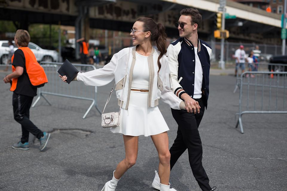 NEW YORK, NY - SEPTEMBER 12:  Mary Leest and Marcel Floruss are seen attending Coach during New York Fashion Week wearing varsity jackets on September 12, 2017 in New York City.  (Photo by Matthew Sperzel/Getty Images)
