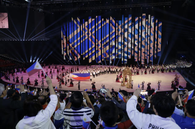 Crowd reacts as the Philippines team walks during the opening ceremony of the 30th South East Asian Games at the Philippine Arena, Bulacan province, northern Philippines on Saturday, Nov. 30, 2019. (AP Photo/Aaron Favila)