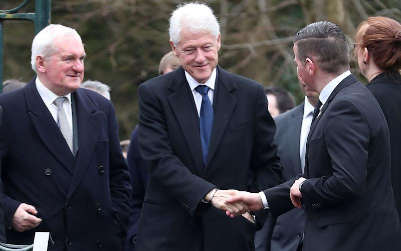 Former US President Bill Clinton (centre) and former Taoiseach Bertie Ahern (left) arriving for the funeral of Northern Ireland's former deputy first minister and ex-IRA commander Martin McGuinness, at St Columba's Church Long Tower, in Londonderry. - Credit: Niall Carson/PA