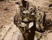 <p>Soldiers, probably from the 12th Battalion, the East Surrey Regiment, in a British communication trench in Ploegsteert Wood, during the Battle of Messines, 11th June 1917. (Tom Marshall/mediadrumworld.com) </p>