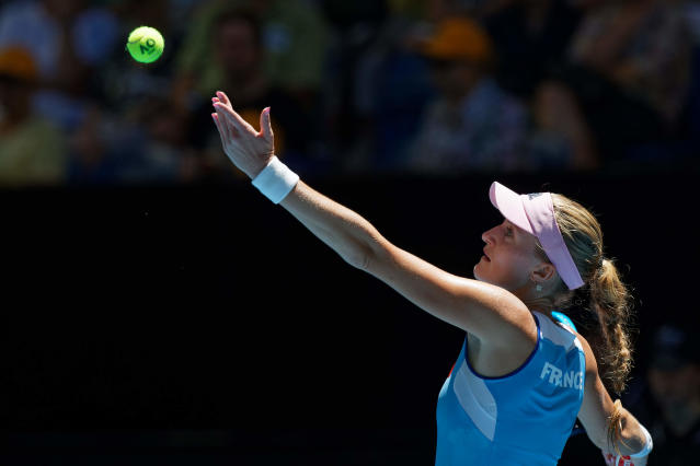 France's Kristina Mladenovic prepares to serve to Australia's Ajla Tomljanovic during their Fed Cup tennis final in Perth, Australia, Saturday, Nov. 9, 2019. (AP Photo/Trevor Collens)