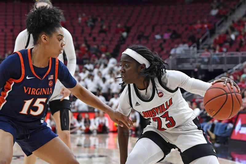 Louisville guard Jazmine Jones (23) looks to drive to the basket as she is defended by Virginia guard Kylie Kornegay-Lucas (15) during the second half of an NCAA college basketball game in Louisville, Ky., Thursday, Jan. 23, 2020. Louisville won 71-56. (AP Photo/Timothy D. Easley)