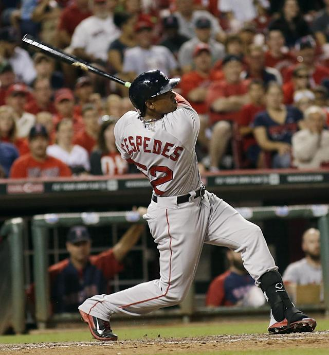 Boston Red Sox's Yoenis Cespedes hits a two-run home run off of Cincinnati reliever Jonathan Broxton scoring Brock Holt in the eighth inning of a baseball game, Tuesday, Aug. 12, 2014, in Cincinnati. (AP Photo/Tony Tribble)