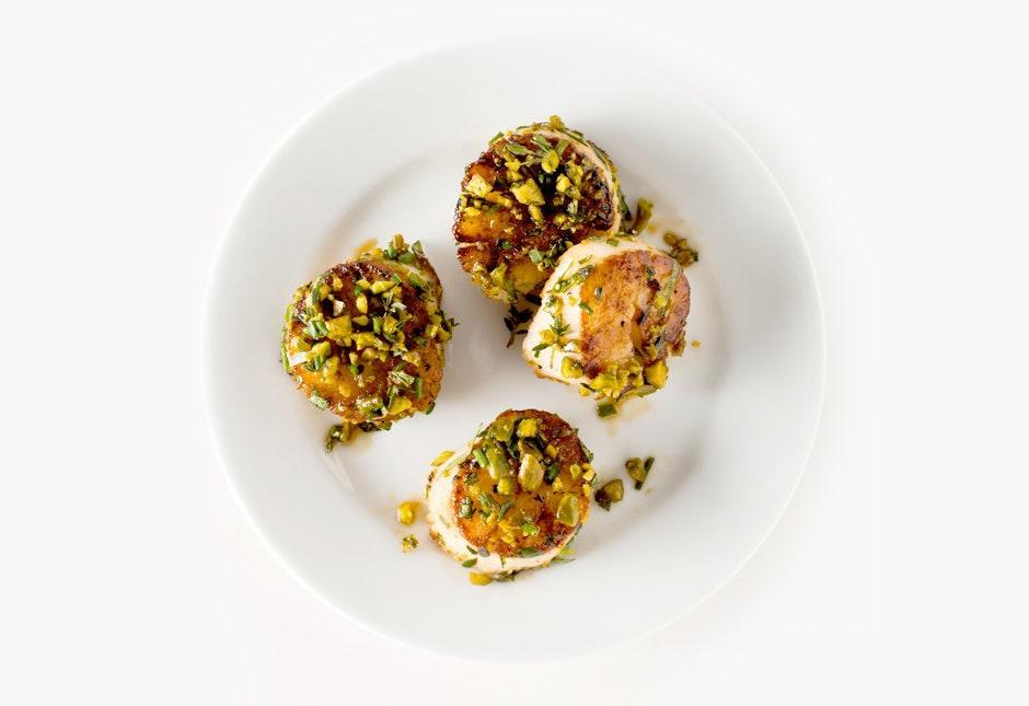 """Chef Viet Pham at Forage in Salt Lake City says: """"For maximum flavor, I like to toast the nuts until they're almost burnt."""" <a href=""""https://www.bonappetit.com/recipe/pistachio-crusted-scallops?mbid=synd_yahoo_rss"""" rel=""""nofollow noopener"""" target=""""_blank"""" data-ylk=""""slk:See recipe."""" class=""""link rapid-noclick-resp"""">See recipe.</a>"""