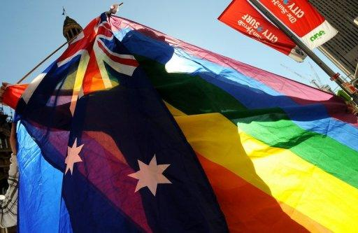 A protester marches through Sydney during a gay rights parade in 2009. Australia's parliament voted overwhelmingly Wednesday to reject gay marriage, after days of heated debate that saw one senator resign from a key role after linking same-sex unions to bestiality