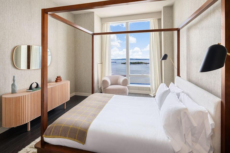 <p>For this retired couple, the worries of the 9-to-5 job are over. Their bedroom is a serene place with Deco furniture and water views.</p>