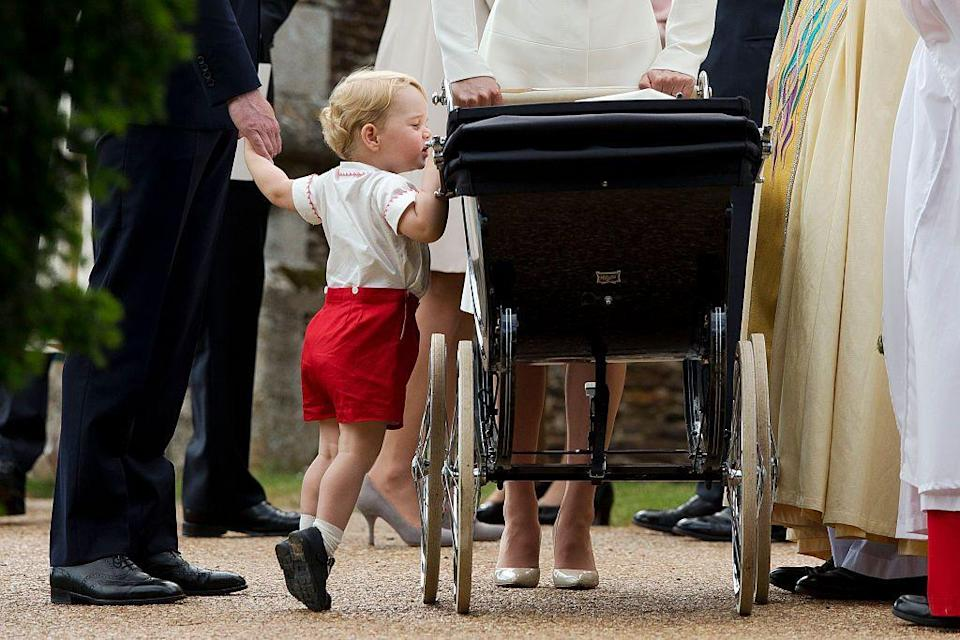 """<p>George was photographed peeping into the pram containing his little sister on her <a href=""""https://www.elle.com/uk/life-and-culture/news/a26292/everything-we-know-about-princess-charlottes-christening/"""" rel=""""nofollow noopener"""" target=""""_blank"""" data-ylk=""""slk:Christening Day in July 2015."""" class=""""link rapid-noclick-resp"""">Christening Day in July 2015.</a></p>"""