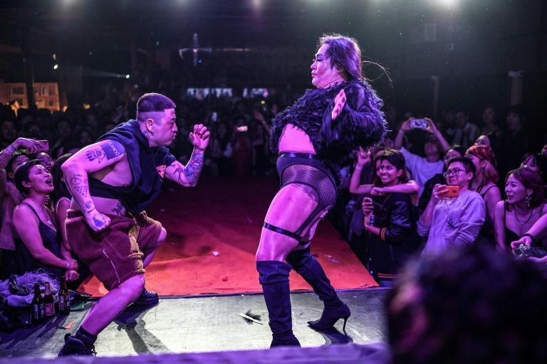 Two dancers competing on stage during a voguing ball at a bar in Beijing