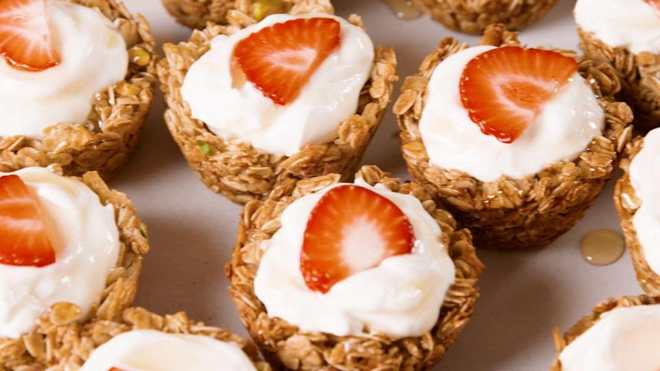 """<p>This spoon-free breakfast is a great way to fill up on healthy fare in the AM. It's a low-fat, low-sugar option that won't leave you feeling sluggish and sleepy, and one batch will last the whole week!</p><p>Get the recipe from <a href=""""https://www.delish.com/cooking/recipe-ideas/recipes/a48755/granola-cups-recipe/"""" rel=""""nofollow noopener"""" target=""""_blank"""" data-ylk=""""slk:Delish"""" class=""""link rapid-noclick-resp"""">Delish</a>.<br></p>"""
