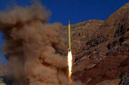 FILE PHOTO: A ballistic missile is launched and tested in an undisclosed location, Iran, in this handout photo released by Farsnews on March 9, 2016. REUTERS/farsnews.com/Handout via Reuters