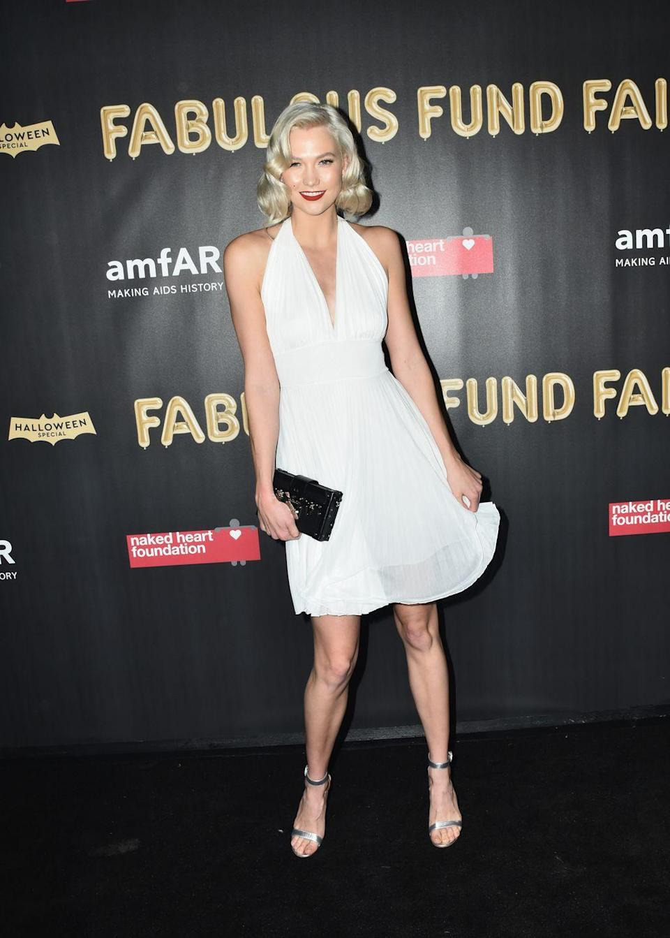 <p>Sure, Karlie isn't winning any points for creativity with her Marilyn Monroe costume, but she's sure as heck getting points for flawless execution! She looks stunning!</p>
