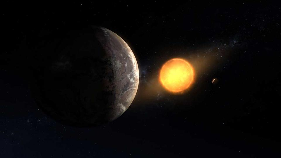 An artist's conception of Kepler-1649c (foreground) orbiting around its host red dwarf star. This newly discovered exoplanet is in its star's habitable zone and is the closest to Earth in size and temperature found yet in Kepler's data.