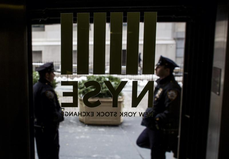 New York City Police officers (NYPD) stand outside a door to the New York Stock Exchange in New York's financial district