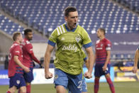Seattle Sounders' Shane O'Neill reacts after scoring against FC Dallas during the second half of an MLS playoff soccer match Tuesday, Dec. 1, 2020, in Seattle. (AP Photo/Ted S. Warren)