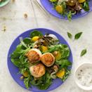 <p>Lemony seared scallops and a walnut vinaigrette top this healthy dinner salad. When shopping for scallops, avoid those treated with sodium tripolyphosphate (STP); it can make them mushy and the scallops won't brown properly. Some scallops have a small white muscle on the side; remove it before cooking.</p>