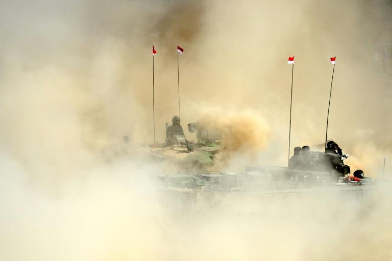 <p>An Indian Arjun Mark II tank drives through sand during a display at the DefExpo 2018, a large defence exhibition showcasing military equipment, on the outskirts of Chennai (AFP Photo/ARUN SANKAR) </p>