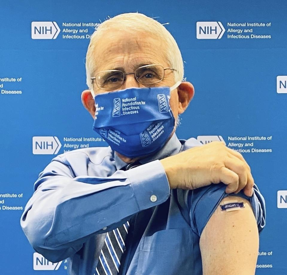 In this September 2020 photo provided by the National Foundation for Infectious Diseases, Anthony Fauci, director of the National Institute of Allergy and Infectious Diseases, National Institutes of Health, shows a bandage on his arm after receiving an influenza vaccine to kick-off the 2020-2021 flu season with the NFID in Bethesda, Md. (NFID via AP)