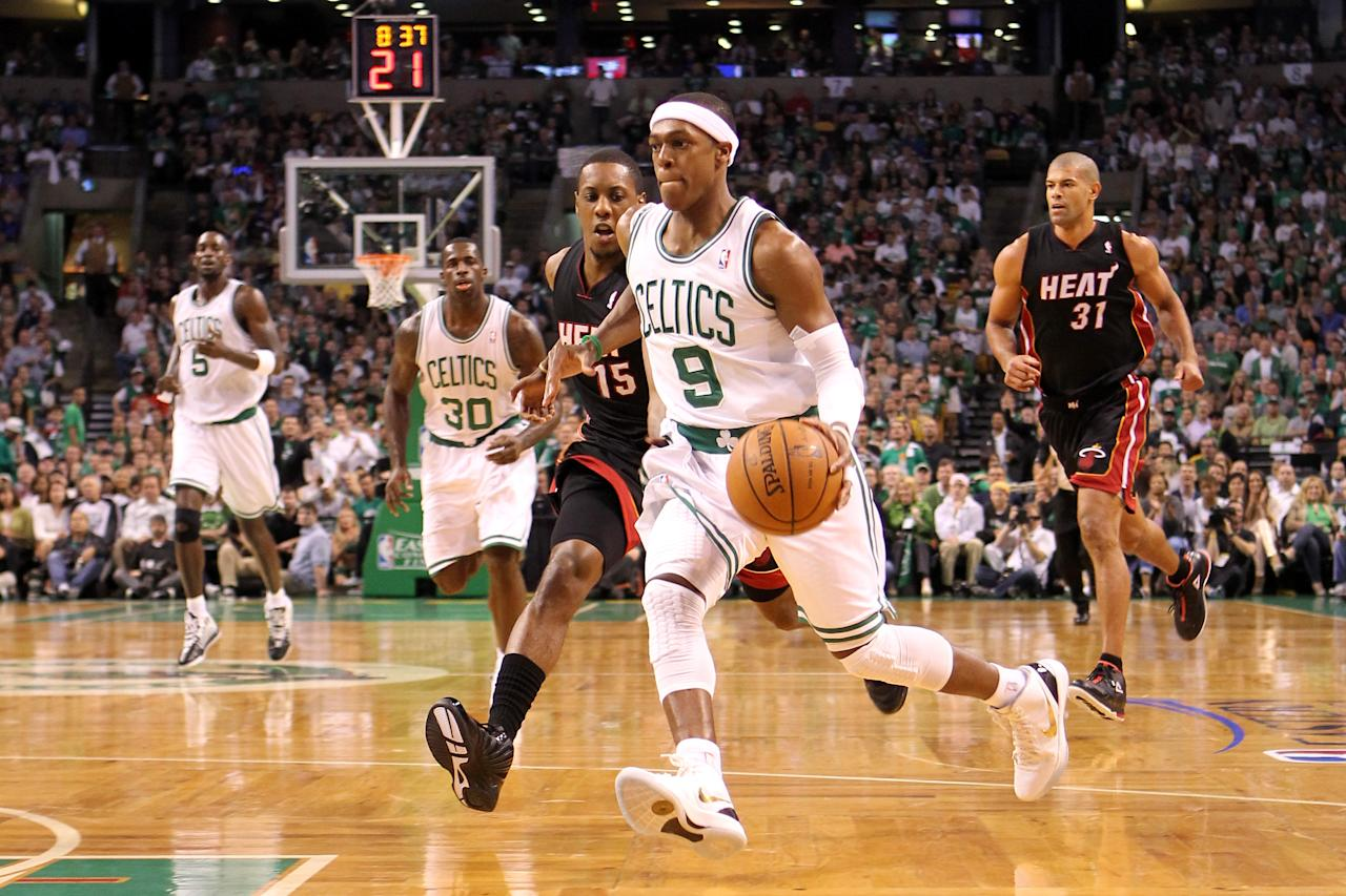 BOSTON, MA - JUNE 03:  Rajon Rondo #9 of the Boston Celtics drives in the first quarter against Mario Chalmers #15 of the Miami Heat in Game Four of the Eastern Conference Finals in the 2012 NBA Playoffs on June 3, 2012 at TD Garden in Boston, Massachusetts. NOTE TO USER: User expressly acknowledges and agrees that, by downloading and or using this photograph, User is consenting to the terms and conditions of the Getty Images License Agreement.  (Photo by Jim Rogash/Getty Images)