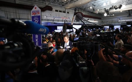Former Rep. Beto O'Rourke talks in the spin room after the 2020 Democratic U.S. presidential debate in Houston