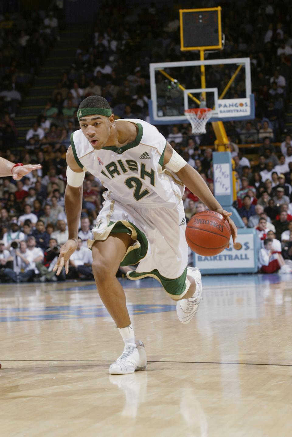 Romeo Travis #24 of St. Vincent-St. Mary High School moves the ball forward against Mater Dei High School during the Ninth Pangos Dream Classic at Pauley Pavilion on the UCLA campus on January 4, 2003 in Los Angeles, California.  St. Vincent-St. Mary won 64-58.  (Photo by Stephen Dunn/Getty Images)