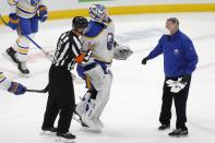 Buffalo Sabres' Ukko-Pekka Luukkonen (1) is helped off the ice during the second period of an NHL hockey game against the Boston Bruins, Saturday, May 1, 2021, in Boston. (AP Photo/Michael Dwyer)