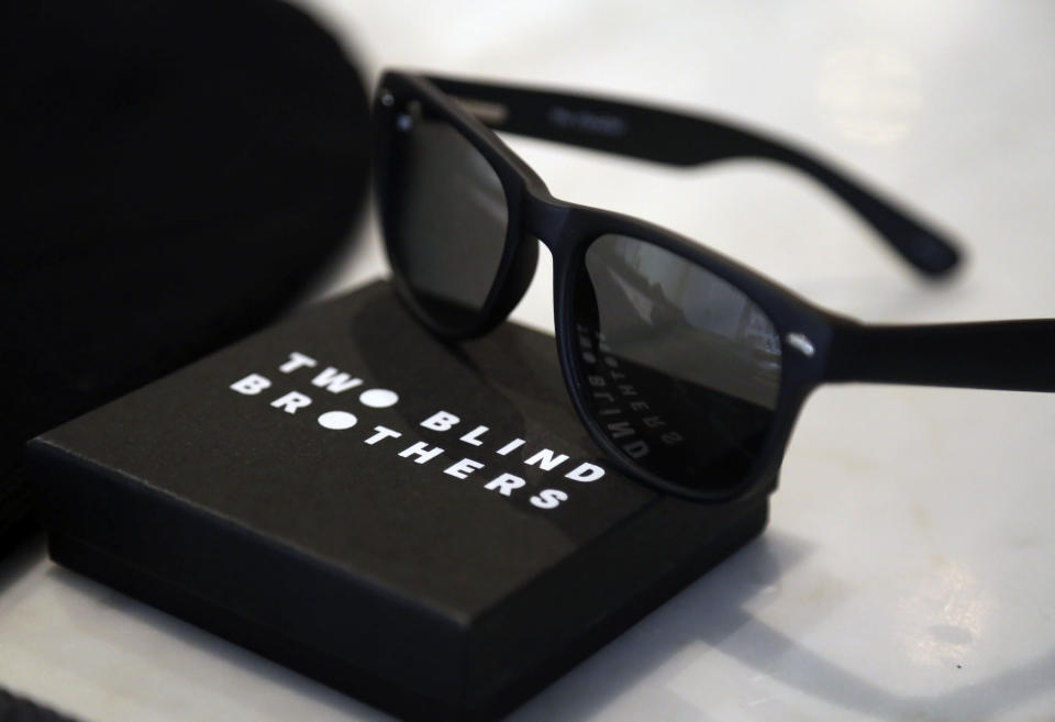 A pair of Two Blind Brothers sunglasses rest on a counter in the Manning brother's New York City loft, on Friday, Oct. 23, 2020. (AP Photo/Jessie Wardarski)