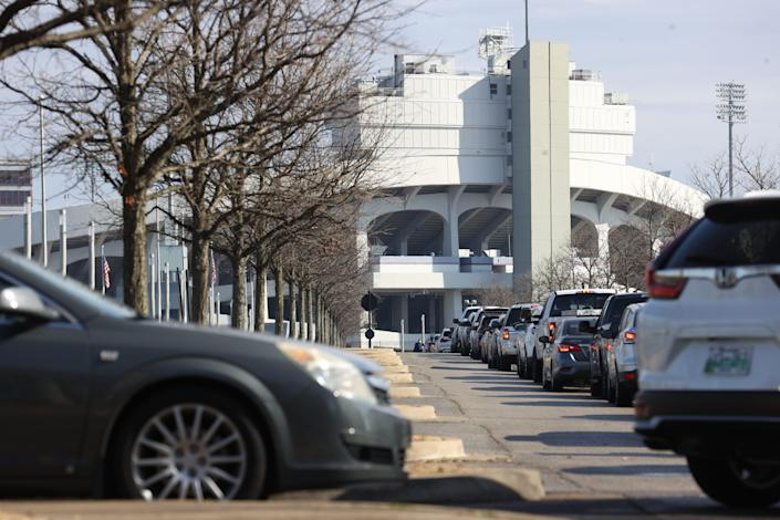 Cars line up outside Liberty Bowl Memorial Stadium for COVID-19 vaccinations in the Pipkin Building on Jan. 27.