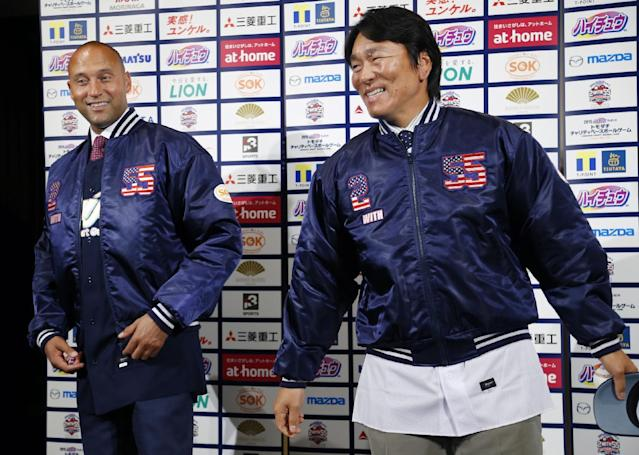 Former NY Yankees Derek Jeter, left, and Hideki Matsui smile after a press conference on a charity baseball game in Tokyo, Wednesday, March 18, 2015. (AP Photo/Shizuo Kambayashi)