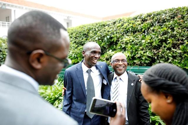 Kipchoge, the marathon world record holder, has his picture taken with a fan after an Interview with Reuters at the state house in Nairobi
