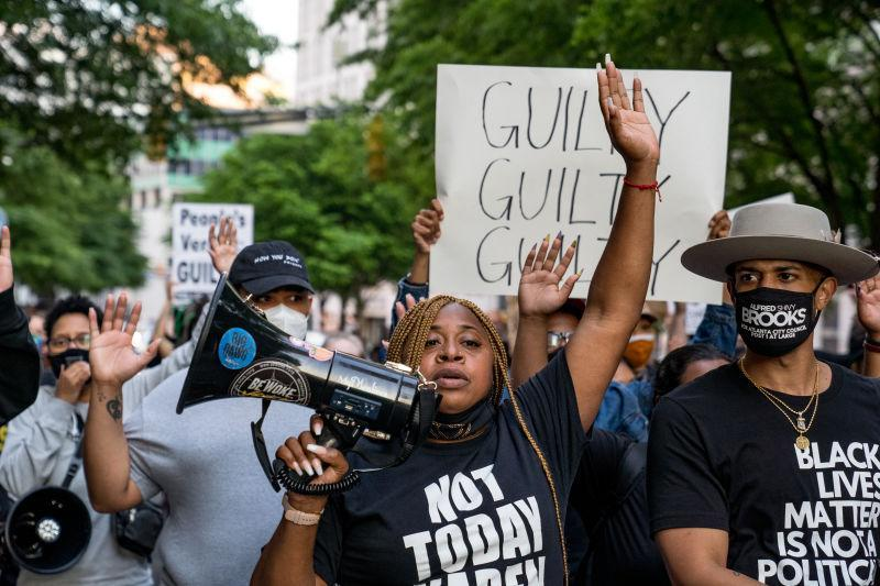 Porsche Queen Miller (center) and others march through the streets after the verdict was announced for Derek Chauvin on April 20, 2021 in Atlanta.