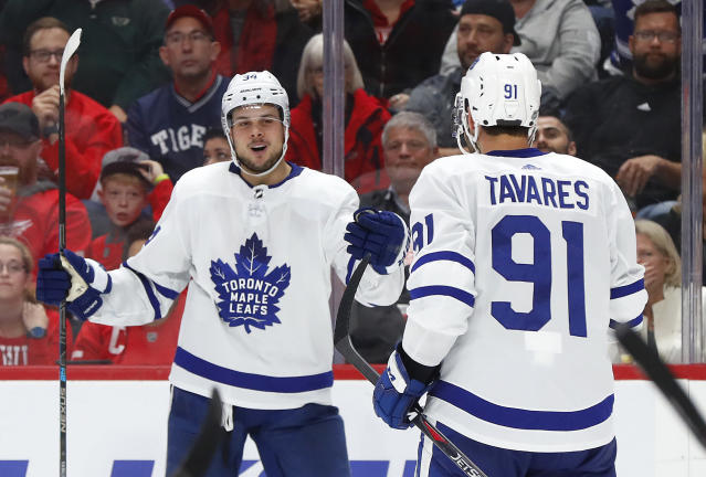Toronto Maple Leafs center Auston Matthews, left, celebrates his goal with John Tavares (91) during the third period of an NHL hockey game. (AP Photo/Paul Sancya)