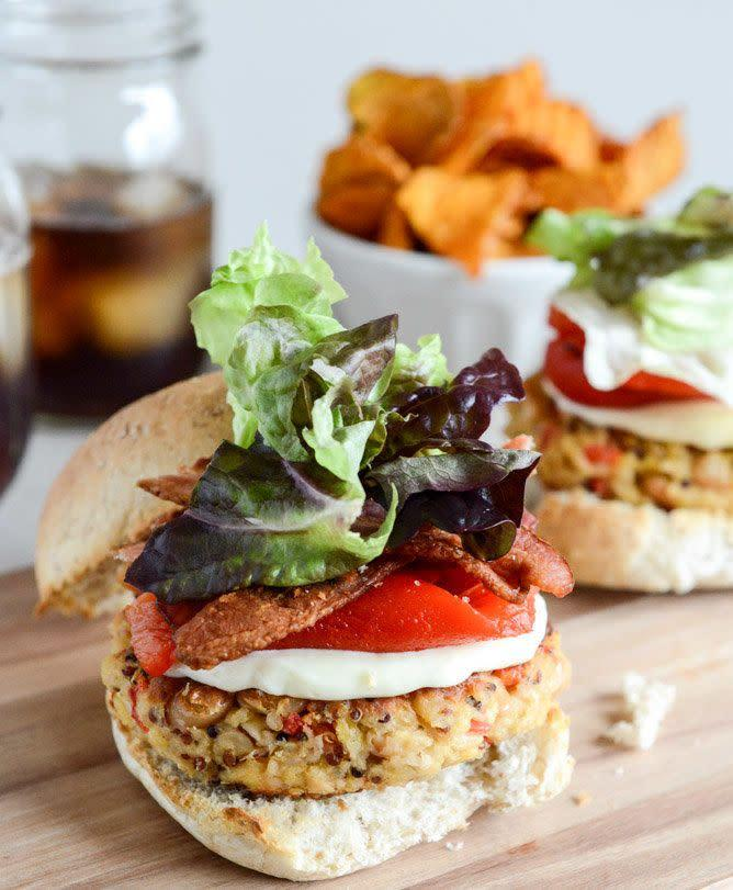 """<strong>Get the <a href=""""https://www.howsweeteats.com/2013/03/roasted-red-pepper-quinoa-white-bean-burgers/"""" rel=""""nofollow noopener"""" target=""""_blank"""" data-ylk=""""slk:Roasted Red Pepper Quinoa Burgers recipe"""" class=""""link rapid-noclick-resp"""">Roasted Red Pepper Quinoa Burgers recipe </a>from How Sweet It Is <br><br></strong> Of course, leave off the bacon if you're a vegetarian."""