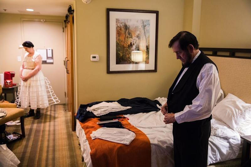 Tom and Sue Wright of Oak Ridge, Tennessee, who have been portraying Abe and Mary Lincoln for 10 years, get dressed in the pre-dawn hours at the Amicalola Lodge in Dawsonville on April 13. | Benjamin Norman for TIME