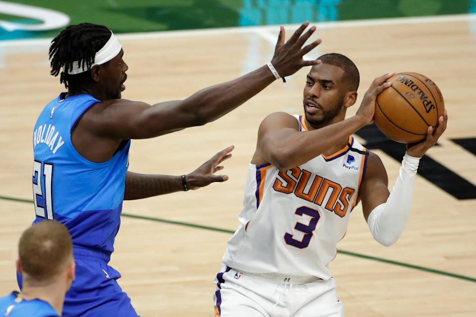 A big storyline in the Finals will be the matchup of point guard Jrue Holiday (21) and Chris Paul.