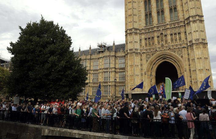 Anti-Brexit supporters take part in a protest near the Houses of Parliament in central London, Wednesday, Aug. 28, 2019. British Prime Minister Boris Johnson maneuvered Wednesday to give his political opponents even less time to block a no-deal Brexit before the Oct. 31 withdrawal deadline, winning Queen Elizabeth II's approval to suspend Parliament. (AP Photo/Matt Dunham)