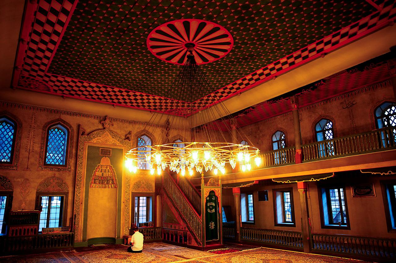"""<p>A man prays at Sulejmanija Mosque in Travnik, Bosnia and Herzegovina, July 20, 2017. Sulejmanija Mosque dates to 1757. """"Sulejmanija Mosque in Travnik is famous because it has many different colors inside. You can compare that with different religions in Bosnia and Herzegovina. Bosnia is beautiful and colourful precisely because of its multiculturalism. That is the true value of this country, which we should preserve and nurture,"""" Effendi Ibranovic Dzemail said. (Photo: Dado Ruvic/Reuters) </p>"""