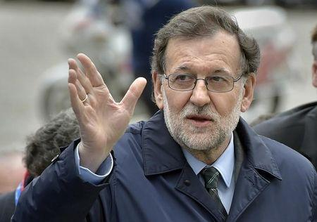 Spanish Prime Minister Mariano Rajoy arrives at a European People's Party (EPP) meeting ahead of a EU summit in Brussels