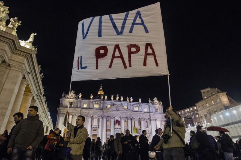 "Faithful hold up a sign with the writing in Italian reading ""Hail to the Pope"" after the election of Pope Francis, the 266th pontiff of the Roman Catholic Church, in St. Peter's Square at the Vatican, Wednesday, March 13, 2013. Cardinal Jorge Bergoglio of Argentina was elected pope. (AP Photo/Angelo Carconi)"