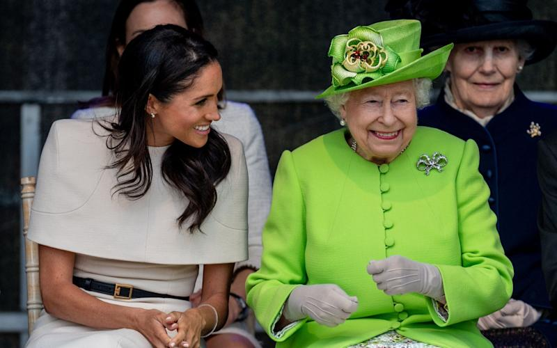Queen and Meghan Markle smiling together - Mark Cuthbert/UK Press