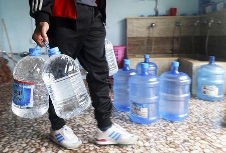 A man carries water in Benghazi