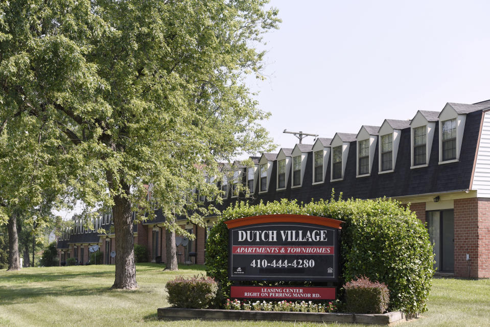 In this Monday, July 29, 2019, photo, a sign sits outside the Dutch Village apartments and townhomes, owned by the Kushner Cos., in Baltimore. Jared Kushner's family real estate firm owns thousands of apartments and townhomes in the Baltimore area, and some have been criticized for the same kind of disrepair and neglect that the president has accused local leaders of failing to address. (AP Photo/Steve Ruark)