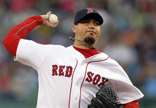 Boston Red Sox's Josh Beckett pitches in the first inning of a baseball game against the Cleveland Indians in Boston, Thursday, May 10, 2012. (AP Photo/Michael Dwyer